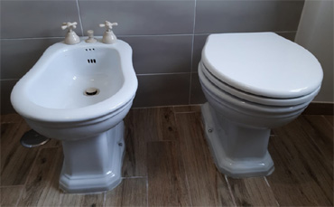 Supply of Impero floor-mounted sanitary ware with 60 countertop washbasin for a private residence in Rome